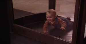 Baby Bink crawls into a rotating door...